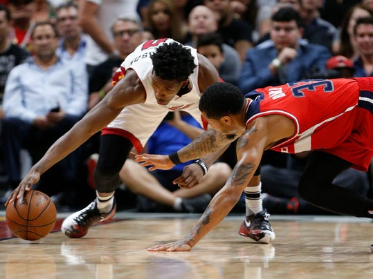 Miami Heat guard Josh Richardson, left, and Washington Wizards guard Trey Burke battle for a loose ball during the second half of an NBA basketball game, Wednesday, April 12, 2017, in Miami. The Heat defeated the Wizards 110-102. (AP Photo/Wilfredo Lee)