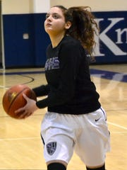 Shadow Hills girls' basketball player Valerie Phlaum, who was born deaf, warms up before a recent game.