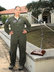 Tech. Sgt. Courtney poses for a photo before the 558th Flying Training Squadron's Undergraduate Remotely Piloted Aircraft Training Course graduation Aug. 4, 2017, at Joint Base San Antonio-Randolph, Texas. Courtney is the first-ever enlisted female to qualify as an RPA pilot. Name badges were blurred due to Air Force limits on disclosure of identifying information for RPA operators.