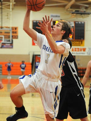 Adam Blunk goes in for a layup for St. Peter's during their game against Norwalk St. Paul Tuesday night. St. Peter's was winning 27-20 at halftime.