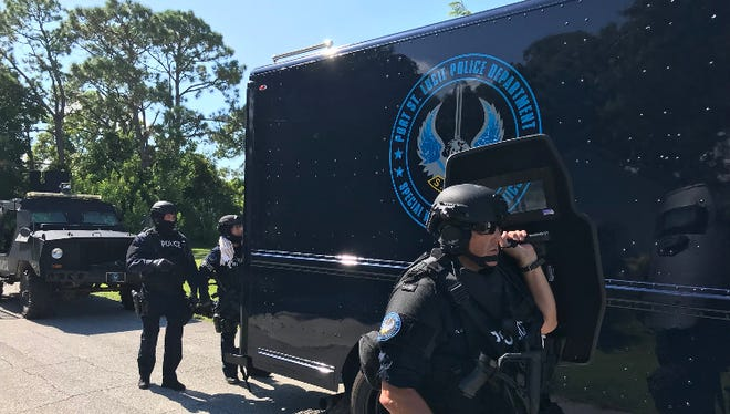 SWAT team on scene of the 400 block of Raymond in Port St. Lucie after a woman barricaded herself into her home.