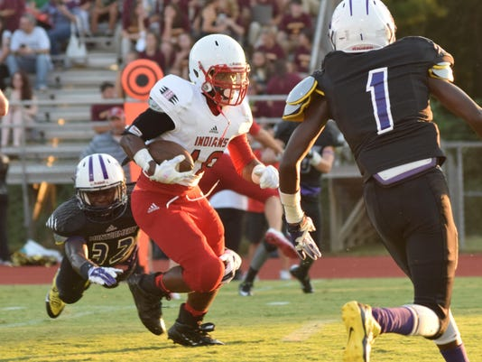 ANI Tioga Montgomery Tioga's Tre Allen (18, left) runs for a touchdown against Montgomery defenders at the Pineville Jamboree Friday, Aug. 28, 2015.-Melinda Martinez/The Town Talk