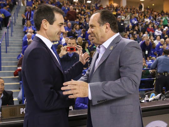 Delaware coaches present (left, Martin Ingelsby) and past (Mike Brey) greet each other before the start of the Blue Hens matchup against Notre Dame at the Bob Carpenter Center last December.