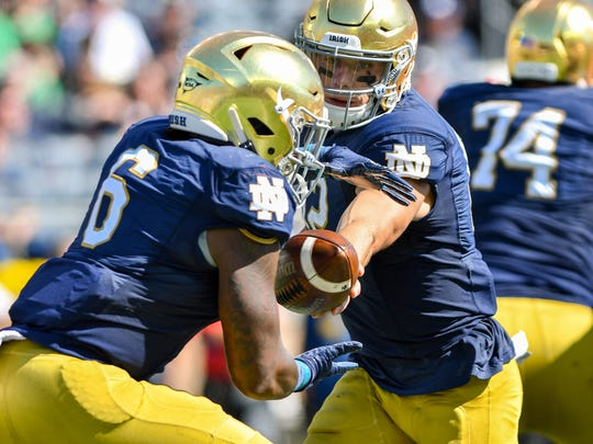 Sep 14, 2019; South Bend, IN, USA; Notre Dame Fighting Irish quarterback Ian Book (12) hands off to running back Tony Jones Jr. (6) in the first quarter against the New Mexico Lobos at Notre Dame Stadium. Mandatory Credit: Matt Cashore-USA TODAY Sports