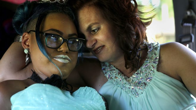 Jerika Bolen and her mother, Jen, share a moment on the way to a July 2016 prom in Appleton. Jerika died in September 2016, after she decided to end treatment for an incurable genetic disease.