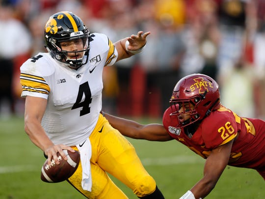 Iowa quarterback Nate Stanley (4) is sacked by Iowa State defensive back Anthony Johnson, right, during the first half of an NCAA college football game, Saturday, Sept. 14, 2019, in Ames, Iowa. (AP Photo/Charlie Neibergall)