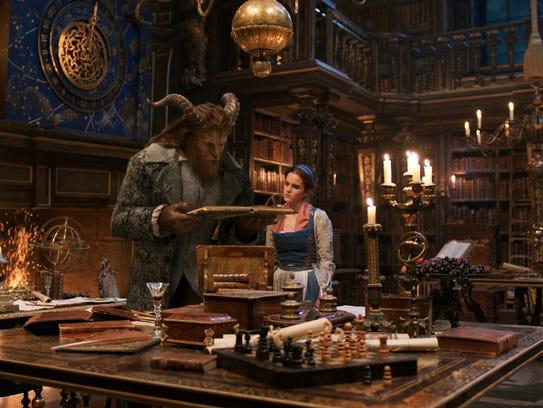 The Beast (Dan Stevens) and Bell (Emma Watson) explore