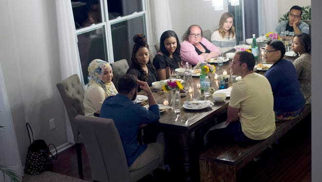 "People gather for a meal during ""Dinner with Your Muslim Neighbor"" on Sunday, June 11, 2017 at Amanda and Hussein Saab's home in New Boston."