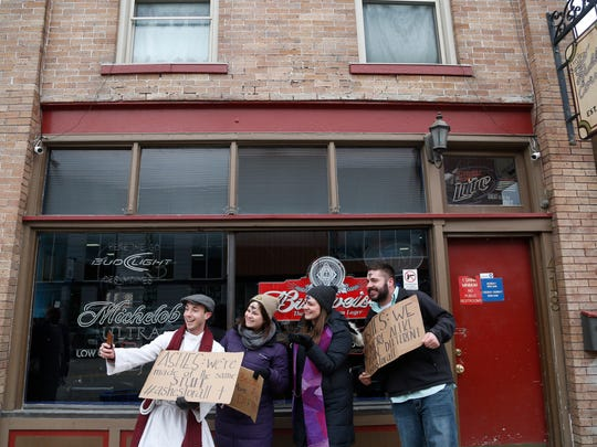 The Rev. Sam Fisher (from left) Lindsay Drake, the Rev. Jen Hibben and Trevor Vaughn take a selfie together Wednesday, March 1, 2017 as members of Ashes for All offer up glitter ashes along East 5th Street in the East Village of Des Moines. Faith leaders were out at several spots around Des Moines for Ash Wednesday.