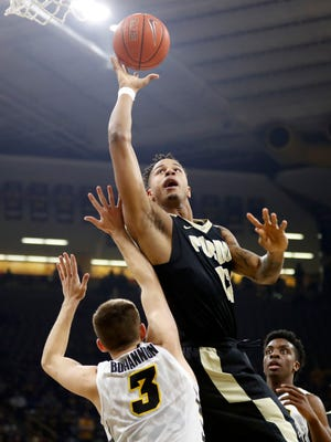 Purdue forward Vince Edwards shoots over Iowa guard Jordan Bohannon (3) during the first half of an NCAA college basketball game, Thursday, Jan. 12, 2017, in Iowa City, Iowa. (AP Photo/Charlie Neibergall)