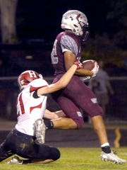 Menomonee Falls' Julius Davis drags Sussex Hamilton's