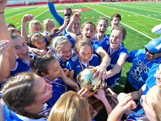 The Sacred Heart girls soccer team celebrates after