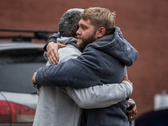 Friends and family of Mark Brito, 27, of Fairfax, embrace outside of Vermont Superior Court in St. Albans on Tuesday, Jan. 3, 2017, following the arraignment of Ethan Gratton, 26, of Georgia, who is accused of shooting Brito and shooting and killing David Hill, 57, of Fairfax during a dispute near Gratton's home in Georgia on Monday.