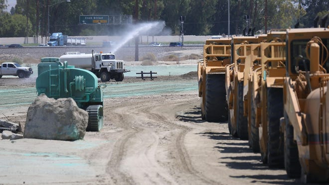 A water truck sprays water at the Millineum Palm Desert construction project, August 28, 2015.