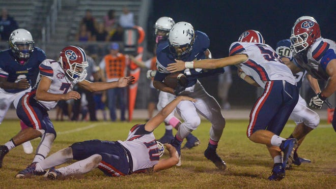 Eau Gallie's Ken McKay eludes defenders during the Commodores' 35-0 win over Cocoa Beach.