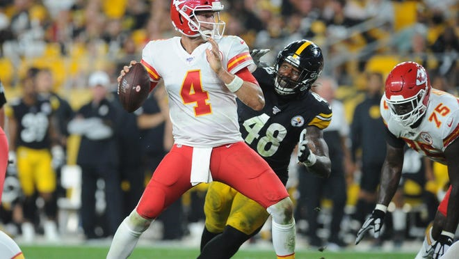 Chiefs quarterback Chad Henne (4) looks to throw as he is pressured by Steelers linebacker Bud Dupree (48) sacks during a preseason game earlier this season.