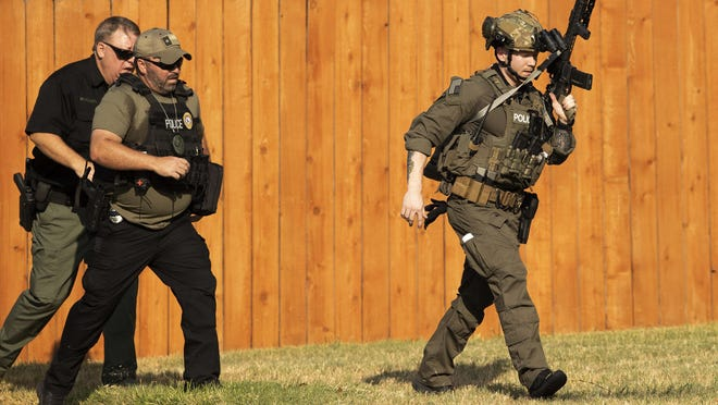 Police officers work near the house on Natalie Cove in the Heritage Park subdivision in Cedar Park where a standoff was happening on Sunday August 16, 2020.