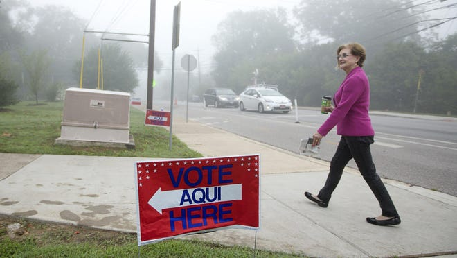 "Travis County Clerk Dana DeBeauvoir walks to a voting location at Zilker Elementary School on Election Day in 2015. While turnout for runoff elections generally runs in single-digits, DeBeauvoir said for July 14 one ""just might get as high as 30%."""