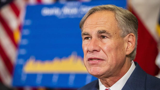 Gov. Greg Abbott, shown at a briefing last month, has started to deliver a stronger message on the seriousness of the coronavirus.