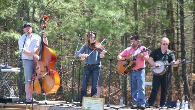 An undated photograph shows a musical performance during the Big South Fork Spring Planting and Musical Festival. The festival is Saturday, April 29, at the Bandy Creek Visitor Center and will feature plowing demonstrations with draft horses and mules, as well as traditional music and craft demonstrations. (NATIONAL PARK SERVICE)