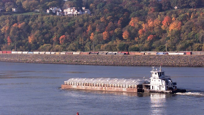 A tugboat pushes a pair of barges down the Mississippi River at Dubuque.