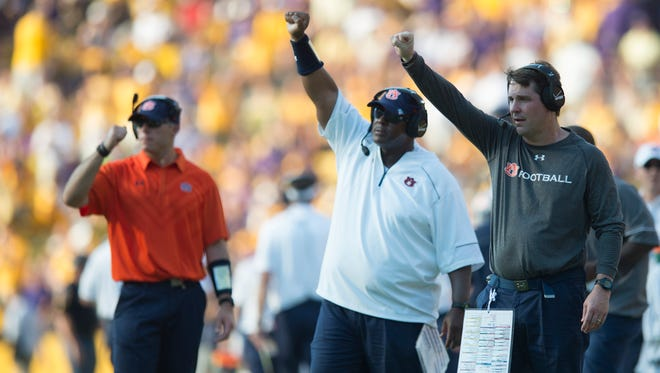 Auburn Tigers defensive coordinator Will Muschamp and defensive line coach Rodney Garner during Auburn's 45-21 loss at LSU on Sept. 19, 2015, at Tiger Stadium in Baton Rouge, La. Muschamp and Garner were the first and third largest paid assistants on the Auburn staff this season.