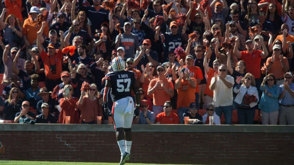 Auburn linebacker Deshaun Davis (57) pumps up the crowd