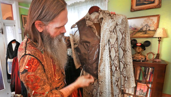 Richard Patrick Anderson shows off his Gaultier snake-skin patterned sports coat.