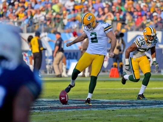 Green Bay Packers kicker Mason Crosby (2) attempts an onside kick against the Tennessee Titans during the second half at Nissan Stadium.