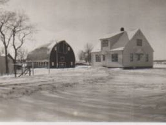 A photo shows the Primus house and barn when the couple was first married in 1949.