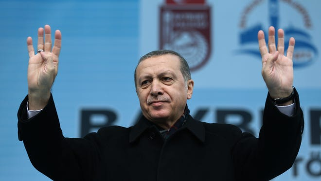 Turkey's President Recep Tayyip Erdogan addresses a rally in Bayburt, Turkey, Friday, Nov. 27, 2015. Russia announced Friday that it will suspend visa-free travel with Turkey amid the escalating spat over the downing of a Russian warplane by a Turkish fighter jet at the Syrian border. Erdogan refused to apologize for the plane's downing, which Ankara said came after it flew for 17 seconds into Turkish airspace. At the same timed, Erdogan said he has tried in vain to speak by phone to Putin to discuss the situation.