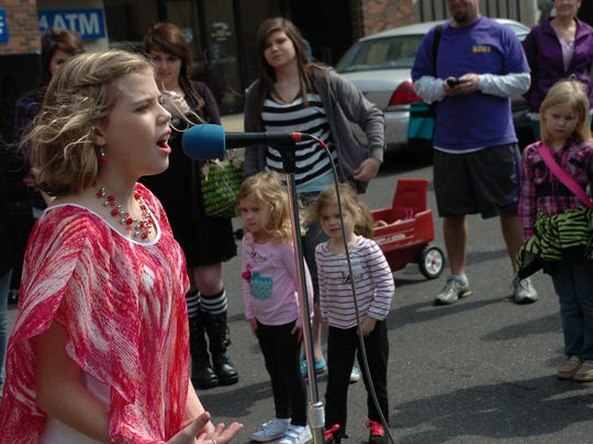 Michelle Willis sings in 2013 at Taking It 2 the Streets in downtown Alexandria.