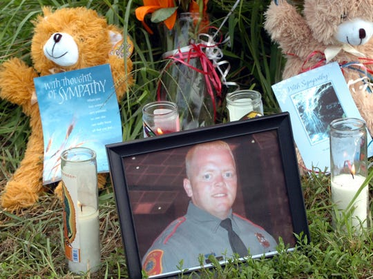 A portrait of Georgetown Patrolman Chad Spicer lays