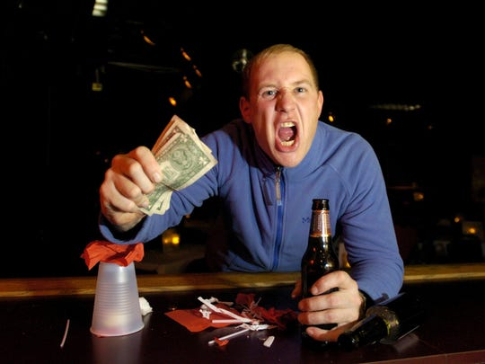 Your bartender does not need you to wave money at them, nor shout over the music/natural bar noise. If you approach a bartender aggressively, they may become aggressive in kind.