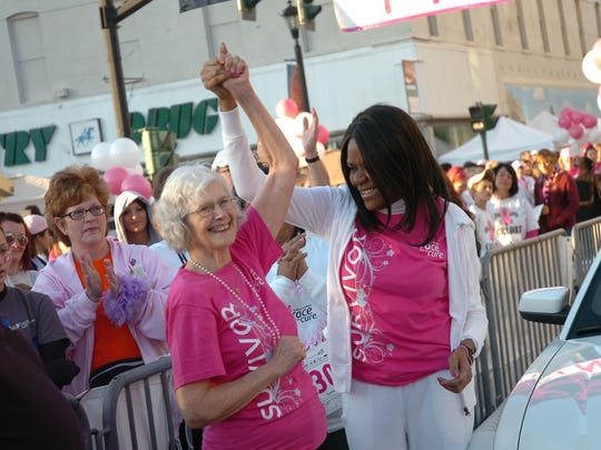 Janice Joseph-Richard poses with breast cancer survivor Jacque Caplan prior to Alexandria's inaugural Susan G. Komen Race for the Cure on Oct. 16, 2010.