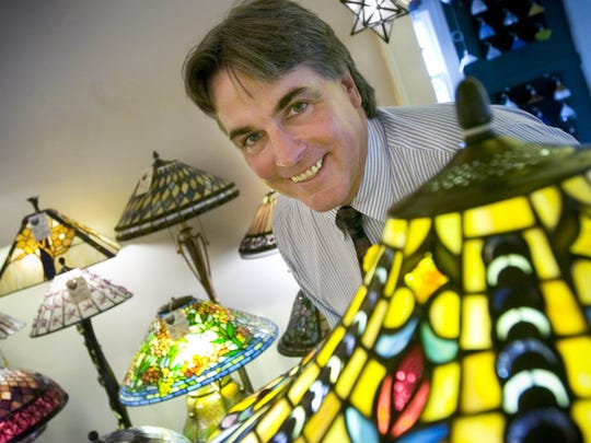 Bruce Bellwood, owner of Tuthill Lighting in Brighton, is surrounded by colorful lamps in this 2005 file photo.