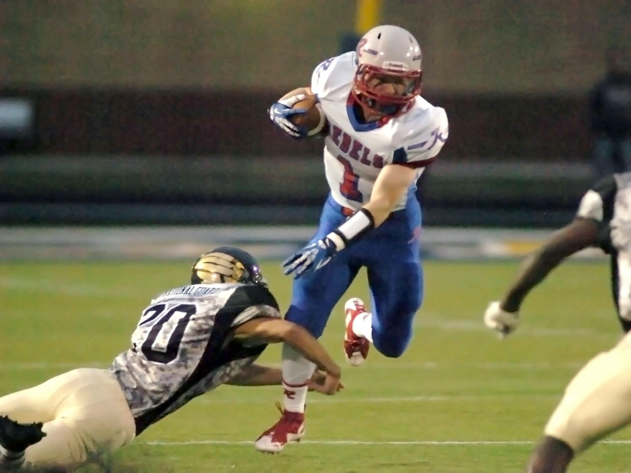 Roncalli's Nate Fries looks for running room in the Rebels' 30-14 win over Decatur Central.