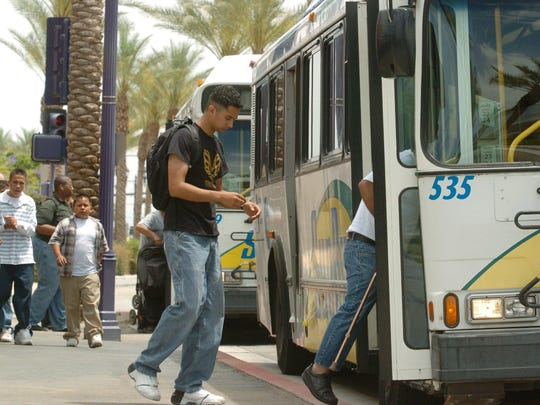 Passengers board SunLine buses along Highway 111 in Cathedral City in this Desert Sun file photo.