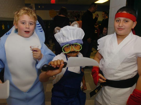 Quinn Thomas-Hagerman (from left), Chris Baynes and Mike Ajluni show off their costumes.