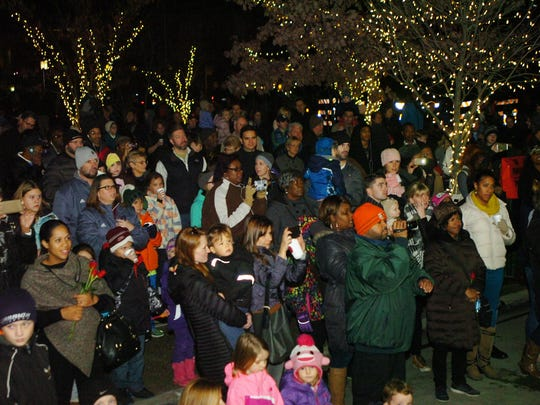 Several hundred people crowded into Shain Park Wednesday for the annual tree lighting ceremony.