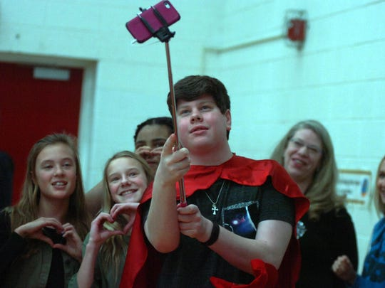 Trevor Sullivan, who received a new heart in November, takes a selfie with Berkshire Middle School seventh-graders.