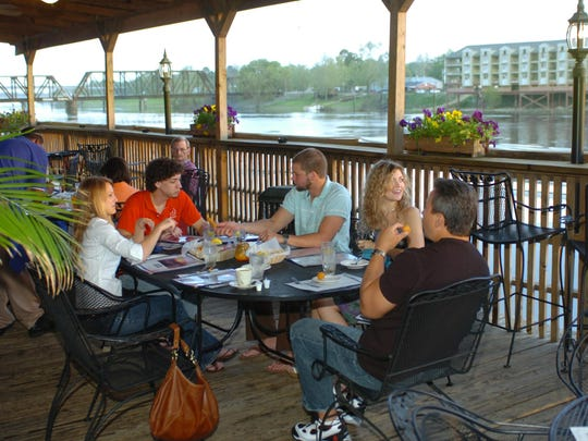 Dinners enjoy their evening meal on the deck of Warehouse