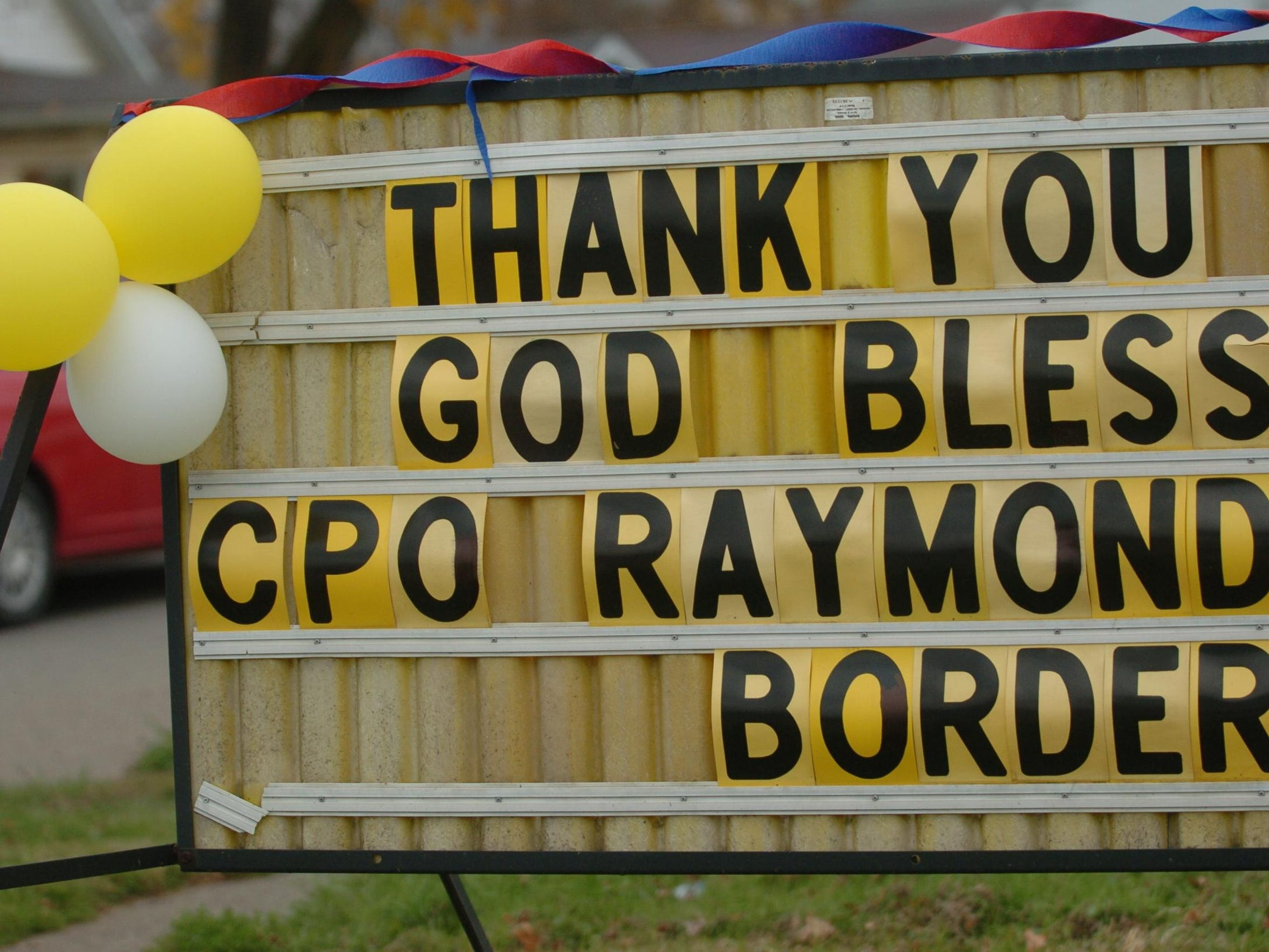 Businesses throughout the county showed support for the family of U.S. Navy Builder Chief Petty Officer Raymond Border with signs and flags.