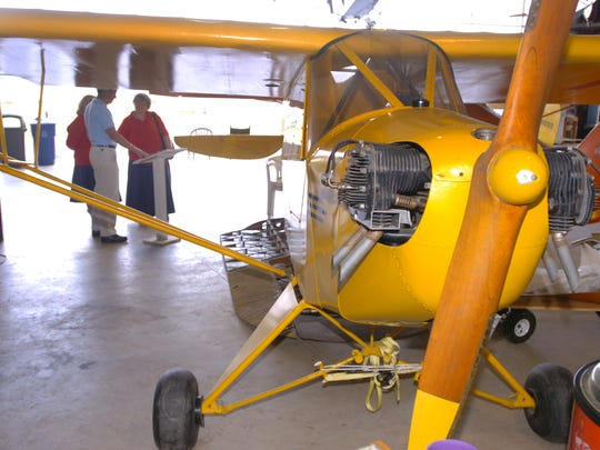WNC Air Museum docent Bill Robinson shows off a 1936 Piper J-2 Cub.