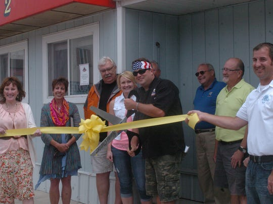 Chris Wiltfang cuts the ribbon for Skaliwags 2, giving 42 new seats to the restaurant.