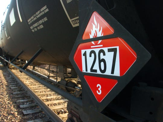 A warning placard is seen on a tank car carrying crude oil in Trenton, N.D. The transport of oil by rail has expanded more than thirtyfold since 2009, raising concerns about spills. Matthew Brown/AP
