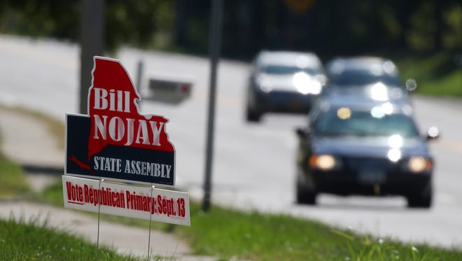 Signs supporting deceased state Assemblyman Bill Nojay, who was seeking re-election, dotted Monroe Avenue near French Road in Pittsford in the days after the primary election in September.