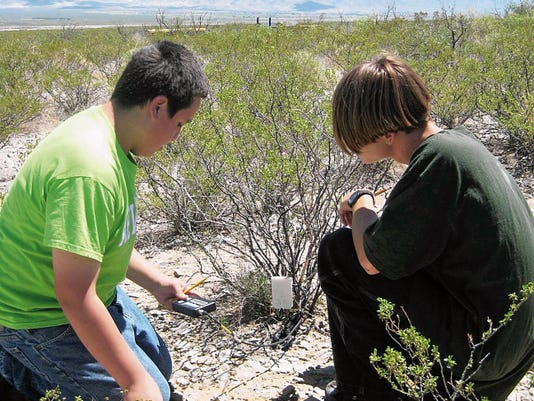 Students work together on science activity at Chihuahuan Desert Nature Park.