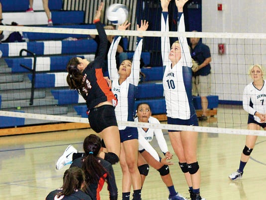 Danny Udero/Sun-News   Silver's Megan Mattie, right assists at the net during Tuesday night's action against Lordsburg. She had 15 kills as well as four aces and four points in the win. She also added nine digs to her stat sheet.