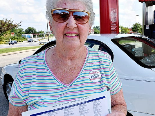 Jan Snyder of Dover Township holds a voter-registration form Saturday as she talks about encouraging people to register to vote.